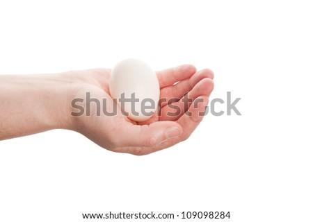 Female hand with white egg isolated on white background - stock photo