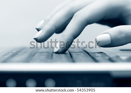 Female hand working on laptop. - stock photo