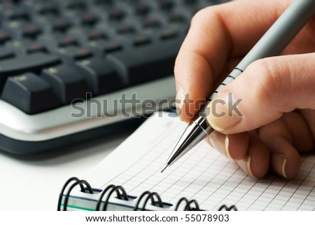 Female hand writing. - stock photo