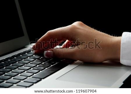 female hand writing on laptot, close up - stock photo
