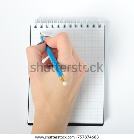 Female hand writing on notebook with white background. isolated