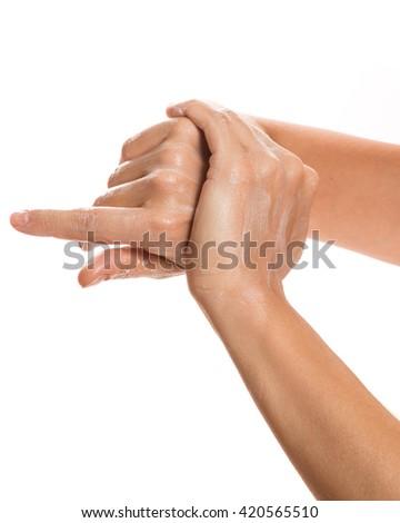Female hands and moisturizing cream on white background - stock photo