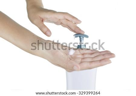 Female hands  applying moisturizer cream on a white background - stock photo