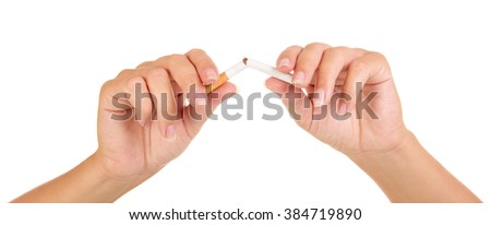 Female hands breaking a cigarette close-up isolated on white background. - stock photo