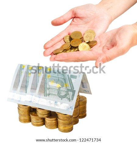 female hands, coins and house built of coins and euro banknotes isolated on white background - stock photo