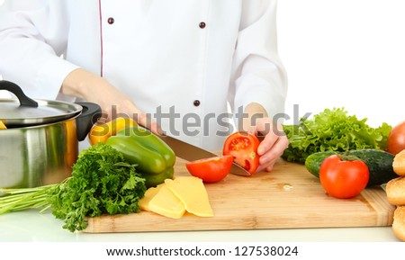 Female hands cutting vegetables, isolated on white