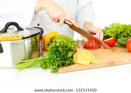 Female hands cutting vegetables, isolated on white - stock photo