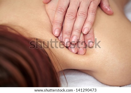 Female hands doing  spa massage on woman back