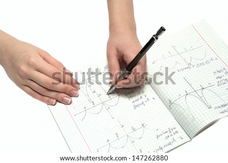 female hands draw graphs and mathematical formulas - stock photo