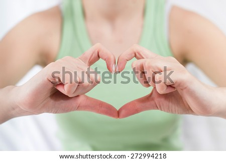 Female Hands form Heart shape.  - stock photo