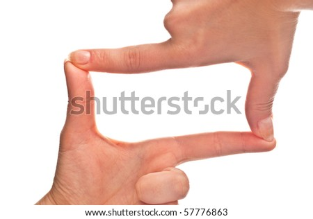 Female hands forming a frame. Isolated on a white background. - stock photo