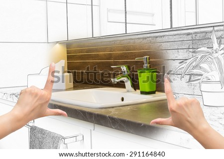 Female hands framing custom bathroom design. Combination drawing and photo. - stock photo