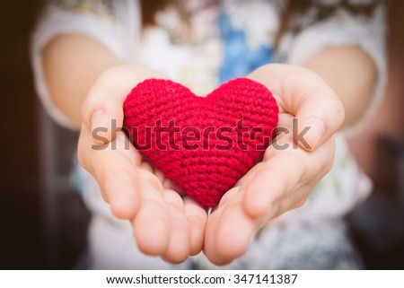 Female hands giving red heart, valentines day concept