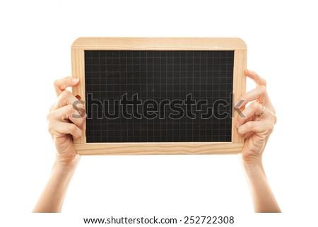 female hands holding a blackboard chalkboard - stock photo