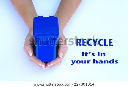 Female hands holding a blue recycling container, it's in your hands, recycle - stock photo