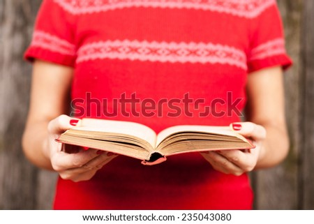 Female hands holding a book - stock photo