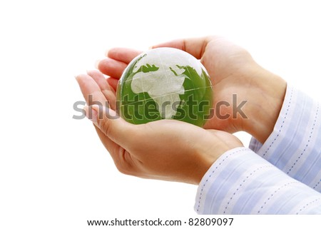 Female hands holding a glass globe