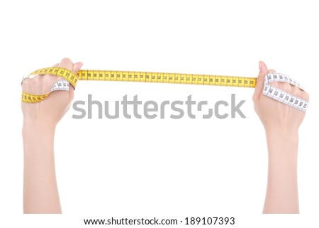 female hands holding a measure tape isolated on white background