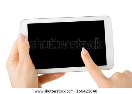 female hands holding a tablet touch pad computer gadget and touches the screen  - stock photo