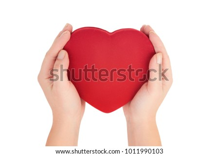 female hands holding bright red heart on white background top view. Love, marriage, engagement, Valentine's day concept