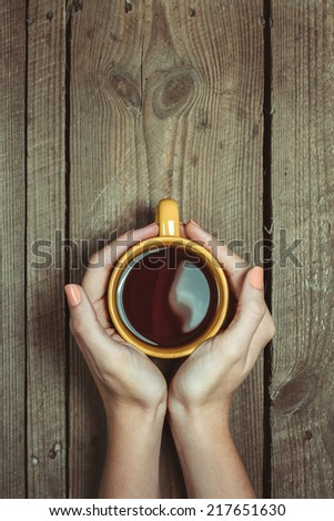 Female Hands Holding Cup Of Coffee - stock photo