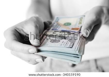 Female hands holding dollars, closeup - stock photo