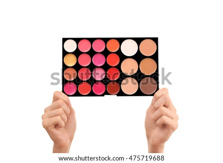 Female hands holding eye shadow palette, isolated on white