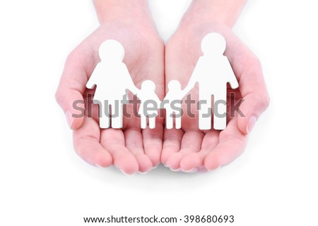 Female hands holding family figure on white background