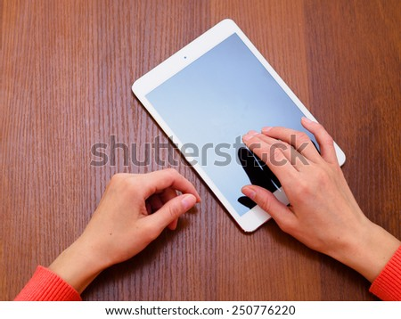 Female hands holding generic tablet - stock photo