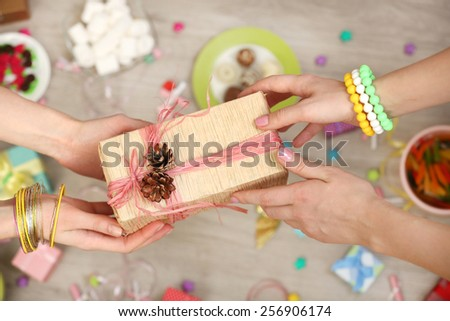 Female hands holding gift close-up - stock photo