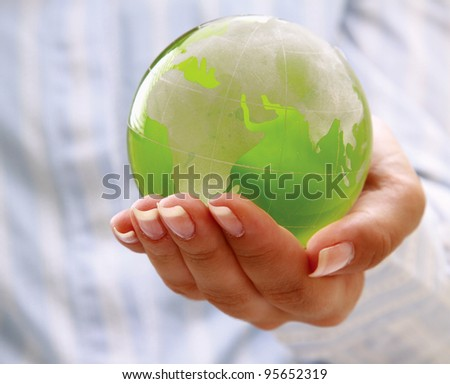 Female  hands holding glass earth