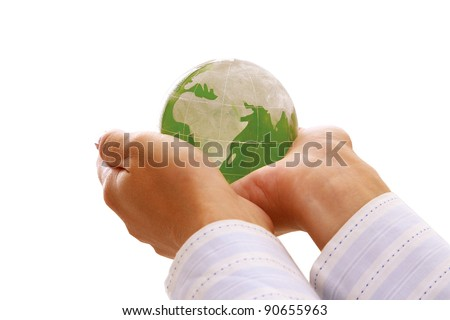 Female hands holding glass earth , isolated on white background - stock photo