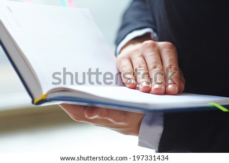 Female hands holding notebook. - stock photo