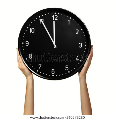 Female hands holding office clock isolated on a white background. Time concept - stock photo