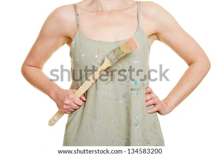 Female hands holding paintbrush in front of dress with color dots - stock photo