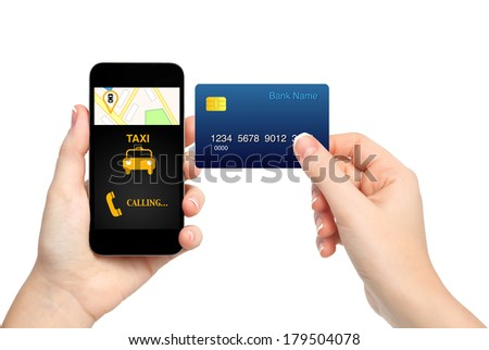 female hands holding phone with interface taxi and credit card on isolated background - stock photo
