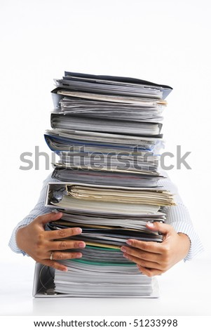 Female hands holding pile of paperwork, over white background