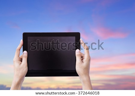Female Hands Holding Tablet over Bueatiful sunset sky background concept smart gadget app web wifi VOIP power up pad data job digital style chat plan ideas education devices