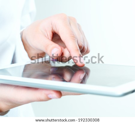 female hands holding tablet pc.