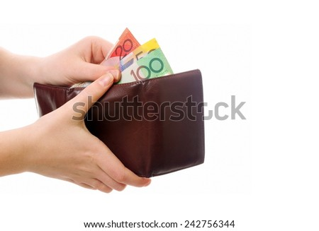 female hands holding wallet with australian money - stock photo