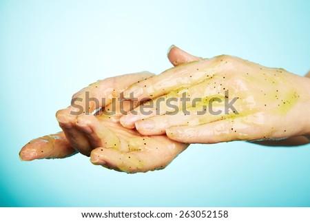 Female hands in body scrub - stock photo