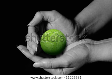 female hands in protective gesture around a green earth globe
