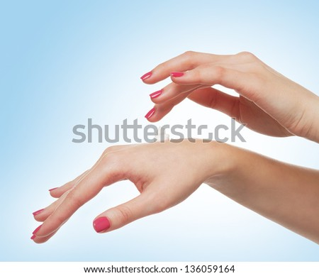 Female hands isolated over blue background - stock photo