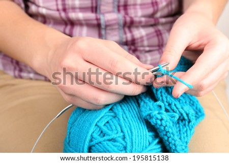 Female hands knitting with spokes close up - stock photo