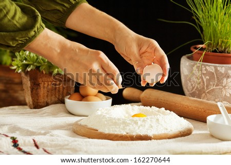 Female hands making dough - stock photo