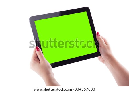 female hands on a white background holding tablet picture with depth of field, selective focus on the tablet.