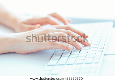 Female hands or woman office worker typing on the keyboard - stock photo