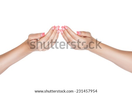 Female hands palms to the top where a beautiful polish with glitter on a white background for cutting. - stock photo