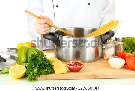 Female hands preparing pasta, isolated on white