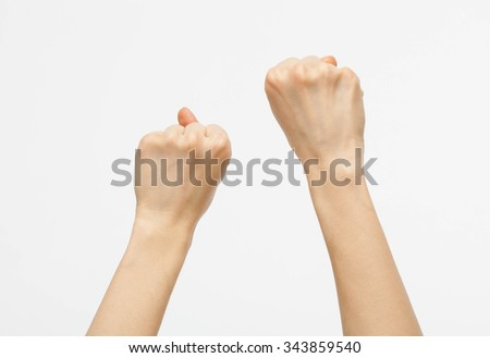 Female hands showing fists raised up, white background - stock photo